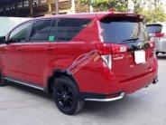 Cần bán lại xe Toyota Innova 2.0 Venturer đời 2019, màu đỏ số tự động giá 830 triệu tại Tp.HCM