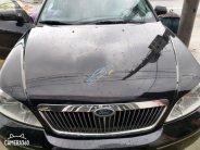 Cần bán Ford Mondeo 2.0 AT năm sản xuất 2004, màu đen   giá 155 triệu tại Hà Tĩnh