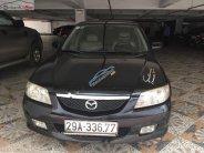 Cần bán lại xe Mazda 323 đời 2003, màu đen xe còn chạy êm giá 165 triệu tại Hà Nội