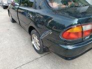 Cần bán gấp Mazda 323 1.6 MT năm 1999, màu xanh lam giá 95 triệu tại Hà Nội