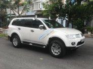 Bán ô tô Mitsubishi Pajero Sport D 4x2 AT 2014, màu trắng số tự động, giá tốt giá 660 triệu tại Tp.HCM