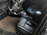 Cần bán Ford Mondeo 2.5 AT đời 2004, màu đen, số tự động giá 149 triệu tại Tp.HCM