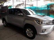Cần bán xe Hilux 2015, động cơ 3.0, số tự động full hai cầu, màu bạc giá 596 triệu tại Tp.HCM