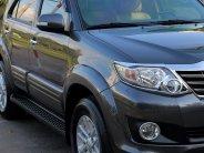Gia đình cần bán xe Fortuner 2014, số tự động, máy xăng, màu xám giá 586 triệu tại Tp.HCM