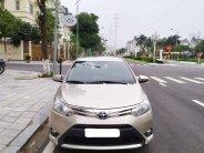 Tôi cần bán chiếc xe ô tô Toyota Vios 1.5E màu ghi vàng 2016 giá 345 triệu tại Hà Nội