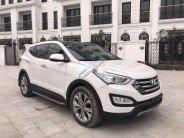 Bán xe Hyundai Santa Fe 2015, màu trắng giá 890 triệu tại Hà Nội