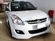 Bán Suzuki Swift 1.4 AT sản xuất 2015, màu trắng, số tự động giá 410 triệu tại Hà Nội