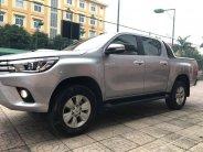 Gia đình cần bán xe Hilux 2015, số tự động, máy dầu, bản 3.0 hai cầu, màu xám giá 653 triệu tại Tp.HCM