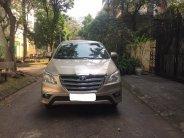 Tôi cần bán chiếc xe ô tô Toyota Innova 2.0E màu ghi vàng 2016 giá 395 triệu tại Hà Nội