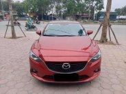 Cần bán lại xe Mazda 6 AT đời 2016, màu đỏ giá 643 triệu tại Tp.HCM