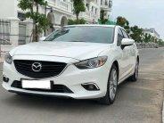 Cần bán Mazda 6 đời 2015, màu trắng, số tự động giá 558 triệu tại Tp.HCM