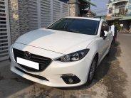 Cần bán xe Mazda3, sản xuất 2017 đk 2018, số tự động, màu trắng giá 339 triệu tại Tp.HCM