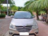 Cần bán Toyota Innova 2.0E đời 2014, màu vàng, ít sử dụng, giá chỉ 385 triệu giá 385 triệu tại Hà Nội