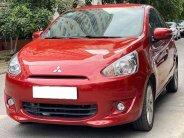 Cần bán Mitsubishi Mirage MT năm 2015, màu đỏ, xe gia đình, giá chỉ 263 triệu giá 263 triệu tại Tp.HCM