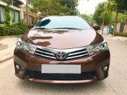 Cần bán gấp Toyota Corolla altis AT đời 2017, màu nâu, chính chủ giá 539 triệu tại Tp.HCM
