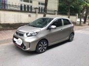 Cần bán xe Kia Morning Si 2016 tự động màu vàng cát giá 306 triệu tại Tp.HCM