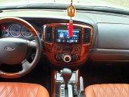 Gia đình bán Ford Escape 2009 XLS, số tự động, màu trắng giá 296 triệu tại Tp.HCM