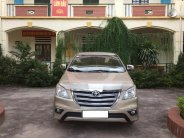 Cần bán Toyota Innova 2.0E đời 2016, màu vàng, chính chủ giá 375 triệu tại Hà Nội