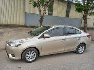 Bán xe Toyota Vios E đời 2015, màu nâu vàng giá 312 triệu tại Hà Nội
